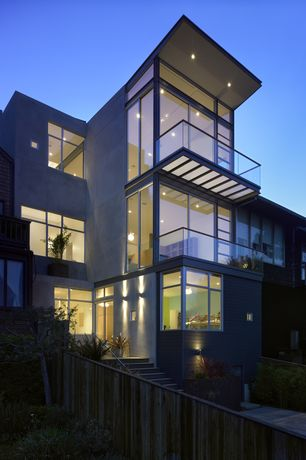 Modern Exterior of Home with Accent exterior architectural lighting