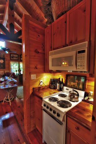 "Country Kitchen with Custom Wood Kitchen Countertops, Over the range microwave, Wood paneling, 20"" electric range, Cabin"