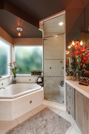Traditional Full Bathroom with wall-mounted above mirror bathroom light, Shower, Flush, Flat panel cabinets, drop in bathtub