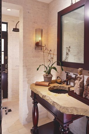 Tropical Powder Room with Exposed brick wall, Painted brick wall, Rain shower head