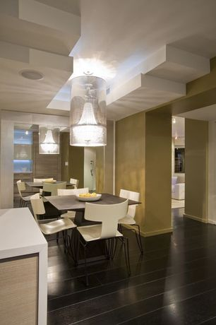 Contemporary Dining Room with Chandelier, High ceiling, Laminate floors