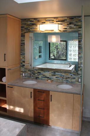 "Contemporary Master Bathroom with Simple marble counters, Kichler crescent view 24"" wide brushed nickel bath light, Skylight"