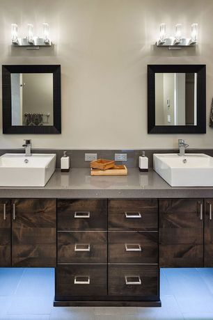 Modern Master Bathroom with limestone tile floors, Simple granite counters, Vessel sink, Double sink, Wall sconce, Flush