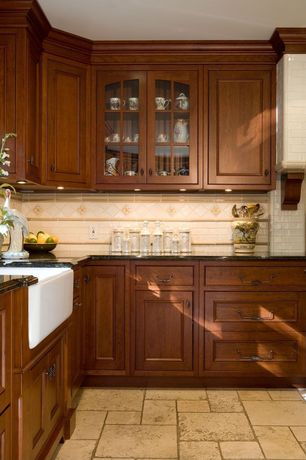 Traditional Kitchen with Farmhouse sink, Raised panel, Custom hood, Simple granite counters, Concrete tile , Glass panel