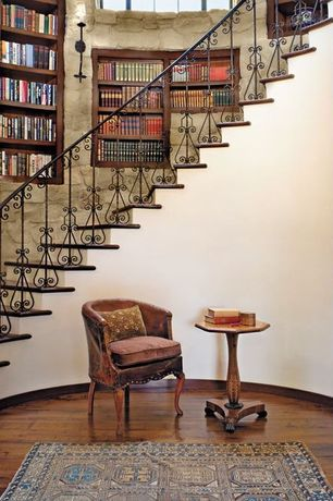 Mediterranean Staircase with Built in bookcase, Butler masterpiece pedestal end table in olive ash burl, Paint