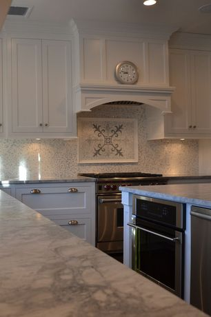 Traditional Kitchen with Flat panel cabinets, Undermount sink, gas range, Kitchen island, Complex granite counters, wall oven