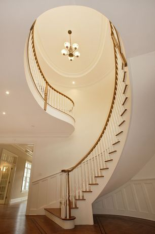 Contemporary Staircase with Wainscotting, Chandelier, Hardwood floors, Loft, Cathedral ceiling, Chair rail