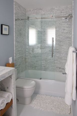 Contemporary Full Bathroom with Complex marble counters, Ann sacks white thassos square field, stone slab showerbath