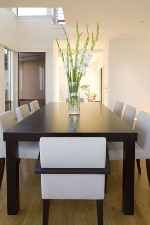 Contemporary Dining Room with Monarch specialties - 1743 rectangular dining table in dark espresso, Oak floors, Paint