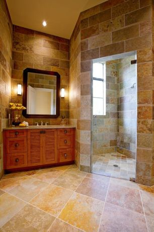 Mediterranean room with Flat panel cabinets, Shower, stone tile floors, Standard height, frameless showerdoor, Inset cabinets