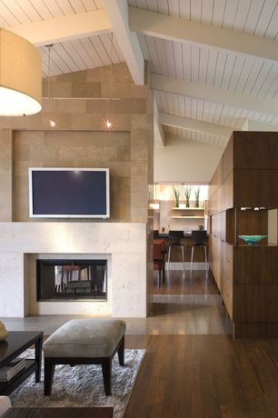 Contemporary Living Room with flush light, Built-in bookshelf, Exposed beam, High ceiling, Drum pendant, Hardwood floors