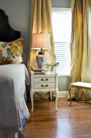Traditional Guest Bedroom with Engineered click hardwood flooring, Paint