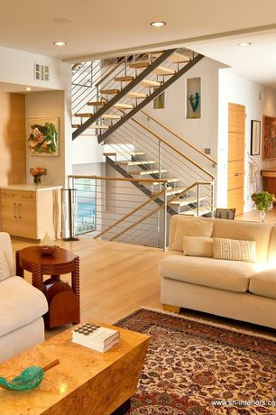 Contemporary Staircase with Standard height, Metal staircase, Hardwood floors, can lights