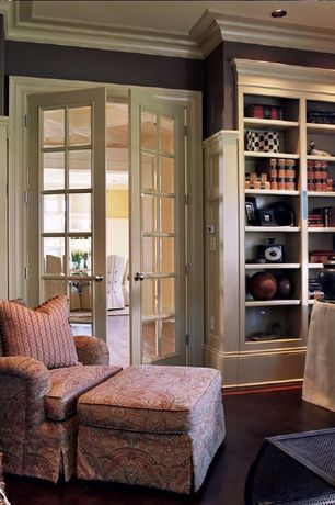 Traditional Living Room with Crown molding, paint2, Chair rail, Sunset Paisley Chair and Ottoman, Built-in bookshelf, Carpet