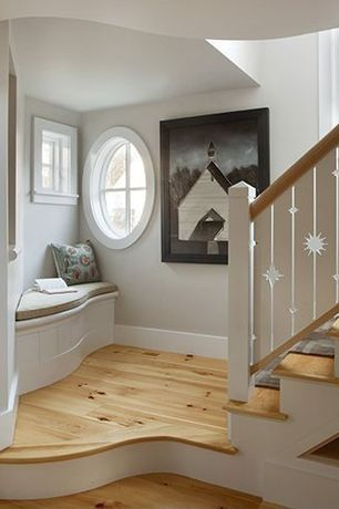 Traditional Staircase with curved staircase, round window, Hardwood floors, Stair landing, Casement, Paint, Standard height