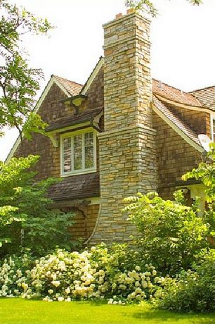Cottage Exterior of Home with Natural stone chimney