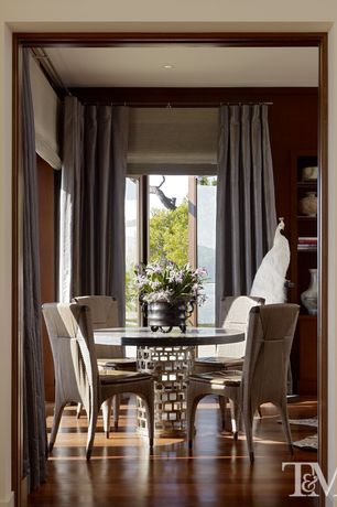 Contemporary Dining Room with Standard height, Laminate floors, Glass panel door, can lights, Crown molding