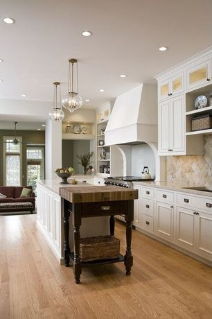 Traditional Kitchen with Custom hood, Stone Tile, Simple granite counters, Glass panel, Flat panel cabinets, Wood counters