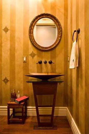 Eclectic Powder Room with Vessel sink, Laminate floors, Powder room