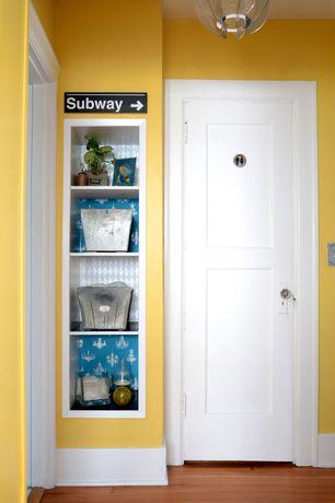 Modern Hallway with Built-in bookshelf, Standard height, Hardwood floors, flush light, six panel door