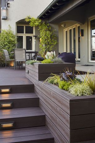 Contemporary Deck with Step light, Composite decking, French doors, Raised beds