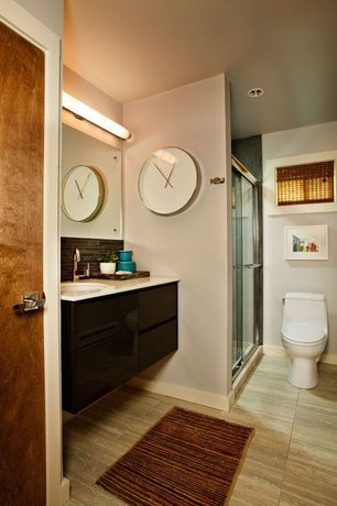Contemporary Full Bathroom with Undermount sink, Simple marble counters, Vinyl floors, Subway Tile, Flush