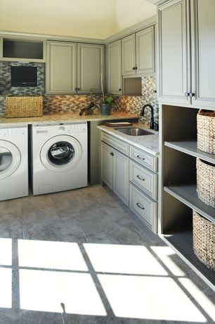 Traditional Laundry Room with Full height tile backsplash, Built-in bookshelf, Crown molding, Concrete floors, Open shelving
