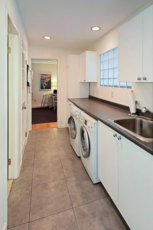 Modern Laundry Room with can lights, Concrete tile , drop-in sink, laundry sink, Standard height, picture window