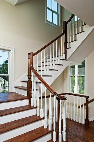 Traditional Staircase with Hand scraped distressed hardwood flooring, Stained oak flooring, White stair railing spindles