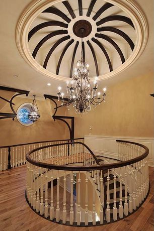 Traditional Hallway with Hardwood floors, Chandelier, Cathedral ceiling, Stained glass window
