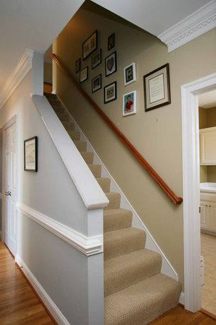 Traditional Staircase with six panel door, Chair rail, terracotta tile floors, Laminate floors, High ceiling
