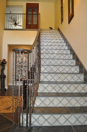 Eclectic Staircase with slate floors, Standard height, curved staircase