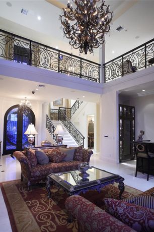 Traditional Living Room with specialty door, Carpet, Cathedral ceiling, Concrete tile , Loft, Crown molding, Chandelier