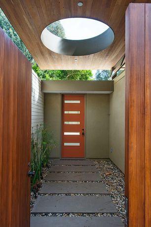 Contemporary Front Door with Pathway, Glass panel door, exterior stone floors