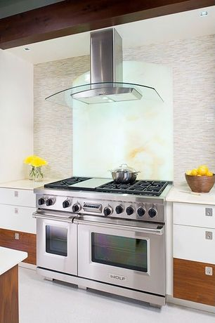 "Contemporary Kitchen with Corian counters, Ceramic Tile, Wolf GR486G 48"" Gas Range - 6 Burners, Infrared Griddle, One-wall"