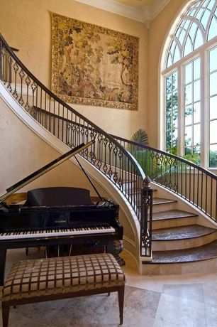 Traditional Staircase with curved staircase, Arched window, Grand piano, High ceiling, Custom wrought iron stair railngs