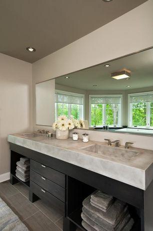 Contemporary Master Bathroom with Complex marble counters, drop in bathtub, Undermount sink, European Cabinets, Bathtub