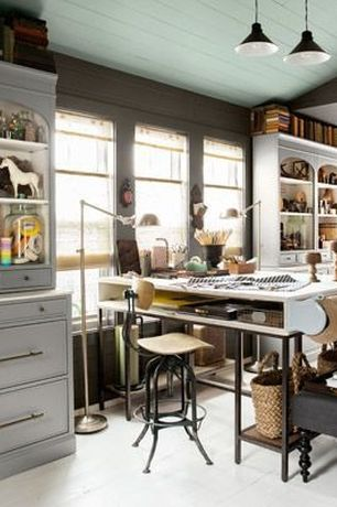 Contemporary Home Office with Built-in bookshelf, Pendant light, Crown molding, double-hung window, Concrete tile