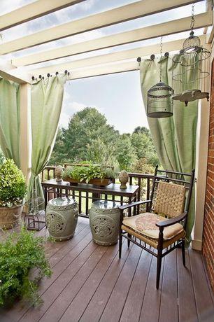 Eclectic Porch with Antique bird cages, Wrap around porch, Porcelain garden stool, Trellis