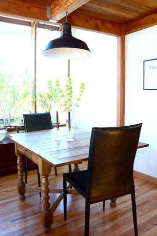 Craftsman Dining Room with Hardwood floors, Pendant light, Standard height, Exposed beam, picture window