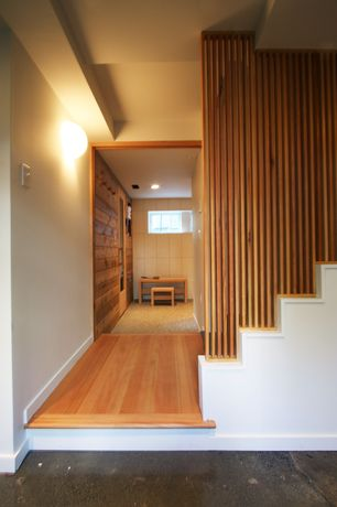 Contemporary Hallway with Wall sconce, Hardwood floors