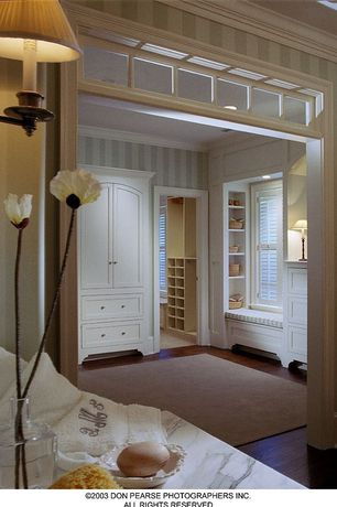 Contemporary Master Bedroom with Hardwood floors, Window seat, Built-in bookshelf, 9' x 13' cream area rug, Transom window