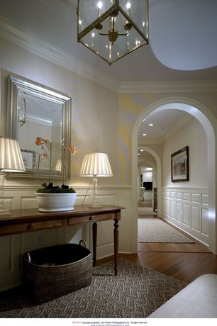 Traditional Entryway with Wainscotting, Crown molding, interior wallpaper, High ceiling, Laminate floors, Chandelier