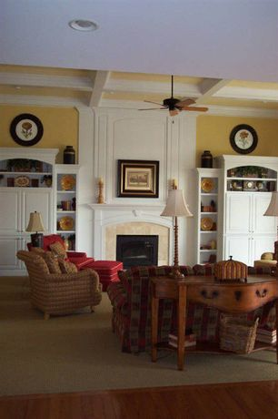 Traditional Living Room with Box ceiling, Laminate floors, Ceiling fan, Built-in bookshelf, High ceiling, Cement fireplace