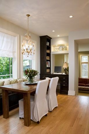 Traditional Dining Room with Built-in bookshelf, Hardwood floors, Chandelier