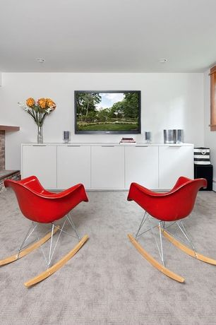 Contemporary Basement with Red molded plastic armchair rocker in red, Carpet, brick fireplace