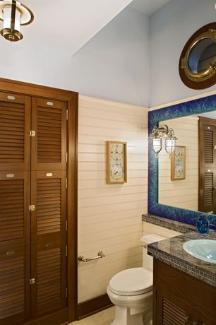 Cottage Powder Room with Simple marble counters, European Cabinets, Inset cabinets, flush light, High ceiling, Louvered door