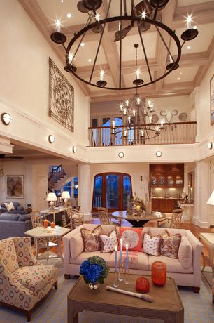 Eclectic Great Room with Cathedral ceiling, Box ceiling, French doors, Chandelier, Loft, Built-in bookshelf, Columns