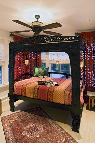 Eclectic Guest Bedroom with Ceiling fan, Pendant light, double-hung window, Standard height, Laminate floors, Chandelier