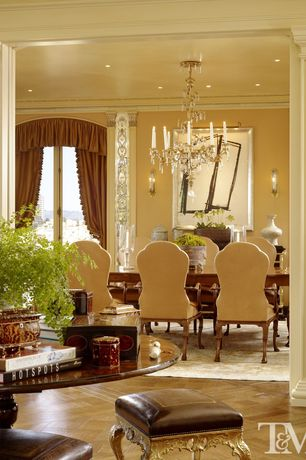 Contemporary Dining Room with Wall sconce, Standard height, Chandelier, can lights, Interlocking Pavers, Crown molding